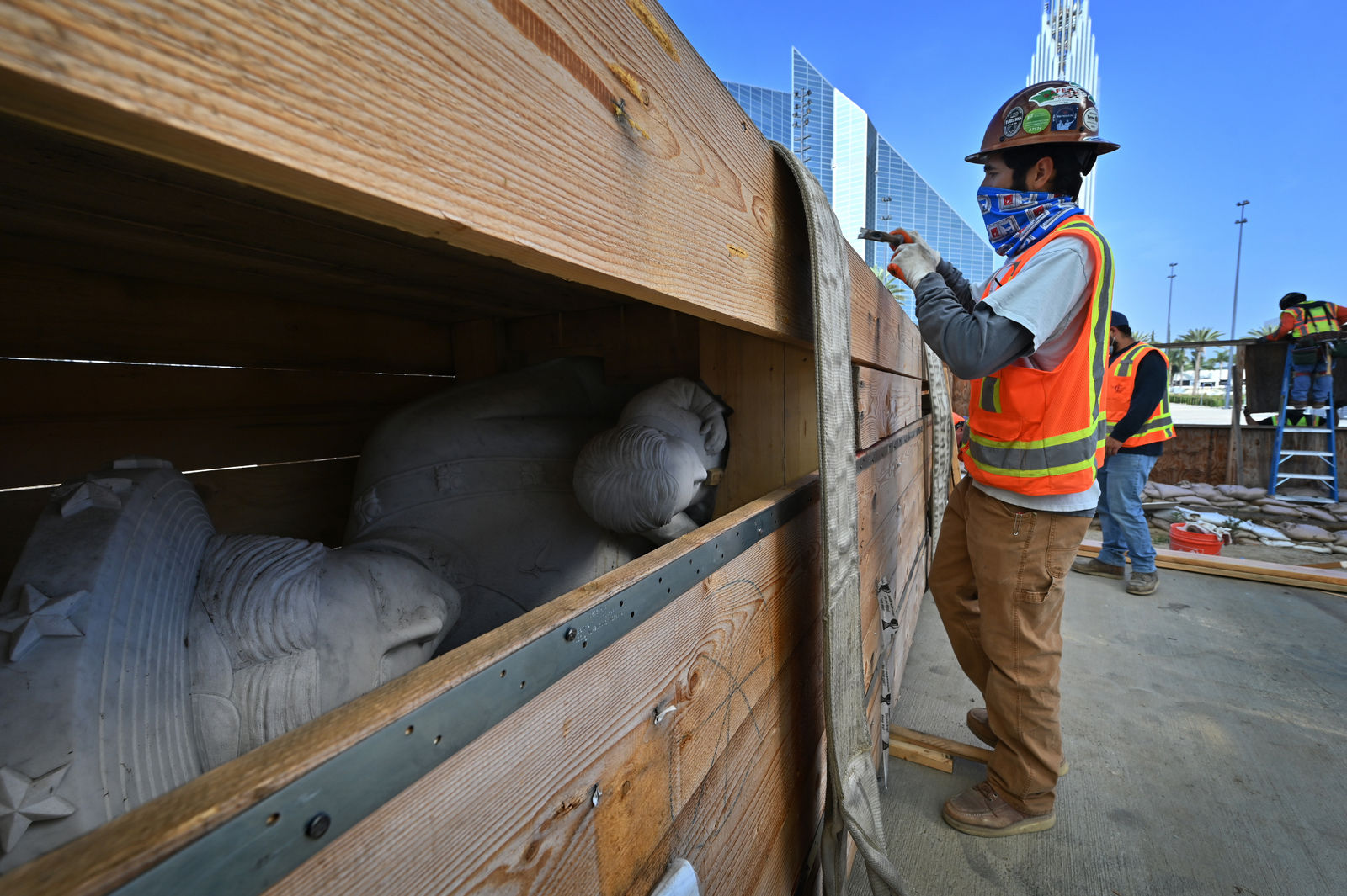 Our Lady of La Vang statue is unboxed for installation at Christ Cathedral. Photo courtesy Diocese of Orange. Note: Photo taken during construction.
