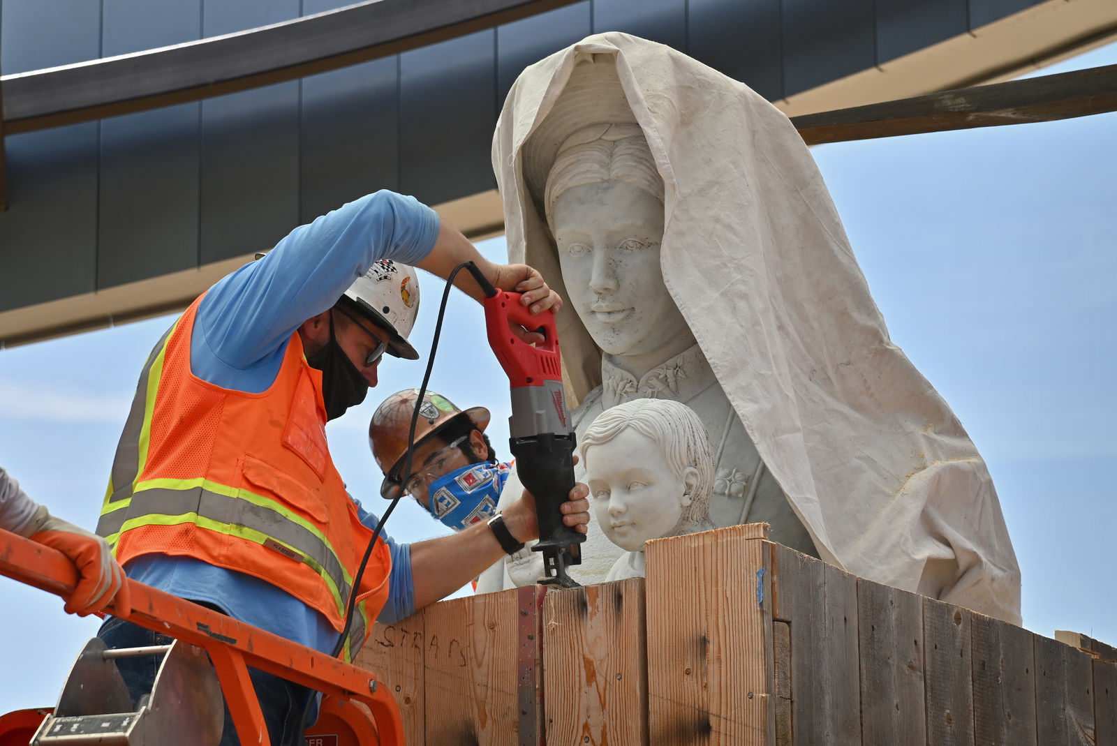 A statue of Mary and baby Jesus is unboxed and prepared for installation in Christ Cathedral's new Catholic Vietnamese memorial being built on the campus. Photo courtesy Diocese of Orange. Note: Photo taken during construction.