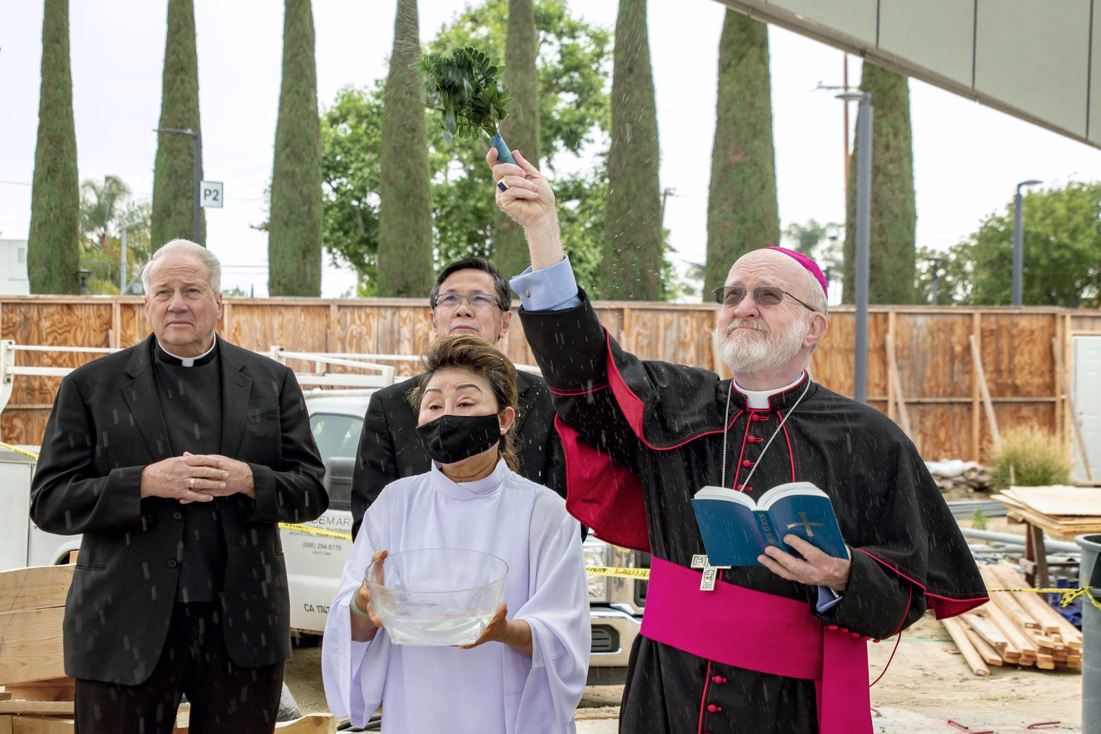 Bishop Kevin Vann blessing the Our Lady of La Vang sculpture during its installation. Photo courtesy Diocese of Orange. Note: Photo taken during construction.