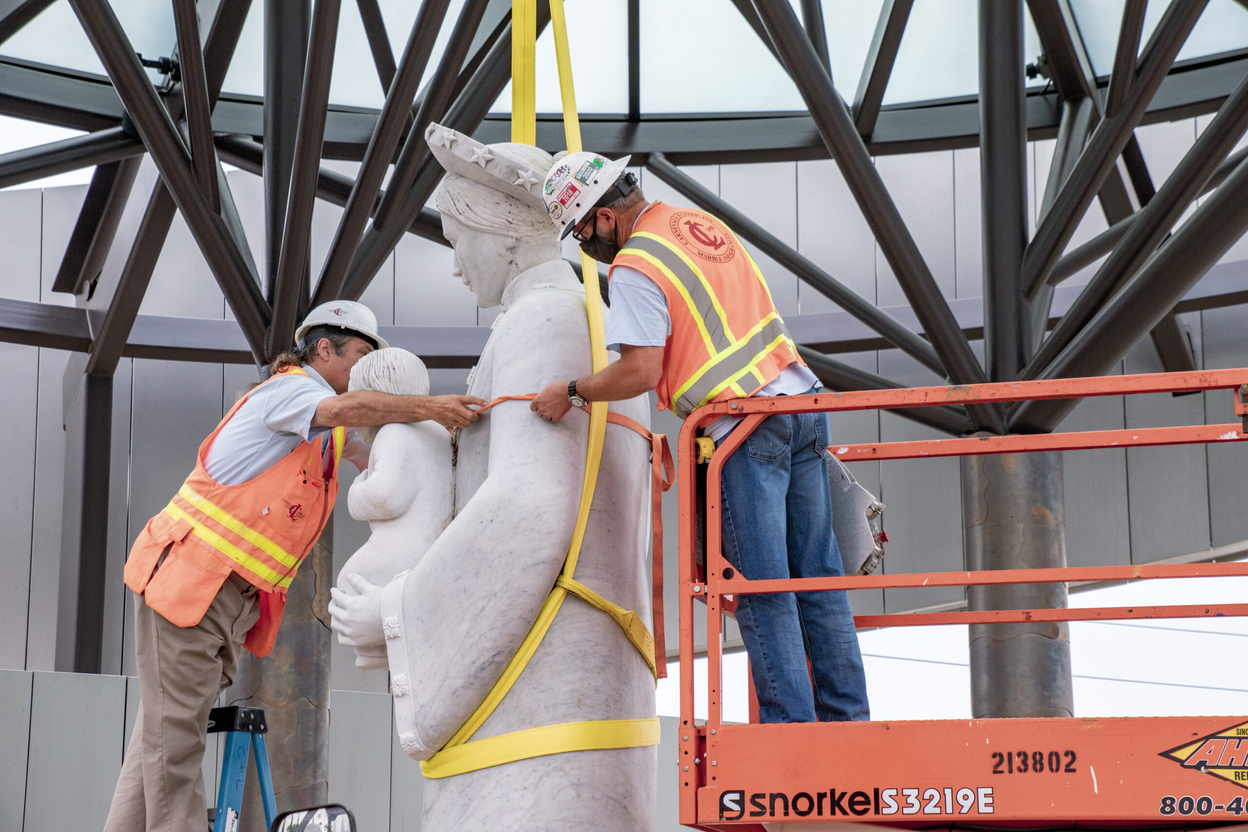 Construction workers gingerly move the Our Lady of La Vang statue closer to her pedestal. Photo courtesy Diocese of Orange. Note: Photo taken during construction.