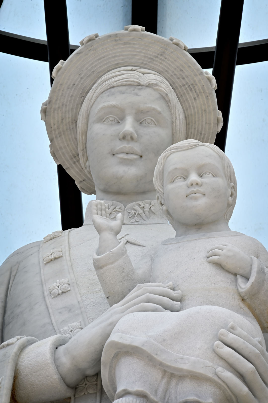 The Our Lady of La Vang statue at the Christ Cathedral campus depicts the Virgin Mary with a Eurasian face, holding the Baby Jesus and wearing a traditional Vietnamese áo dài dress and khăn đống hat. Photo courtesy Diocese of Orange.